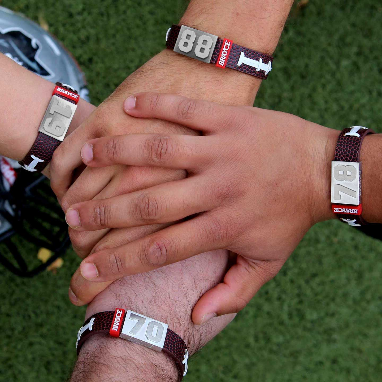 American Football Armband mit vier Trikotnummern für eine Mannschaft